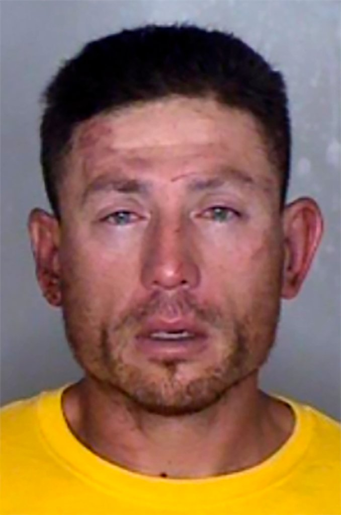 A mug shot of Ryan Scott Blinston. A white man in a yellow shirt stares at the camera in this mug shot. He has light injuries on his forehead, right cheekbone and above his right eye.