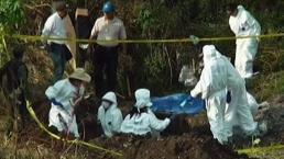 Identifican 56 cuerpos en fosa clandestina
