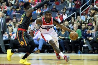 Wall y los Wizards derrotan al Miami Heat