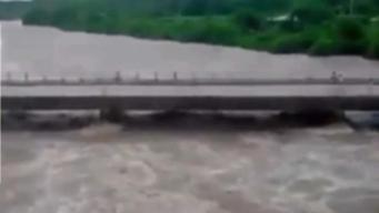Evacuados y vías incomunicadas por lluvias en Cuba