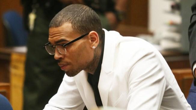 Acusan a Chris Brown de huir de choque