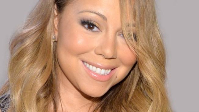 Mariah Carey festeja con poca ropa