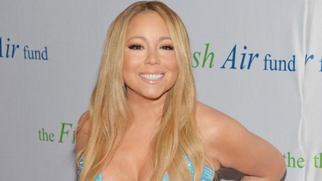Mariah Carey vestida de gala en el subte